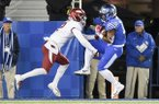Kentucky receiver Clevan Thomas Jr. (18) catches a touchdown pass while being defended by Arkansas defensive back Kamren Curl (2) during a game Saturday, Oct. 12, 2019, in Lexington, Ky.