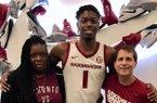 ESPN 4-star Keon Ambrose-Hylton, his mother and Arkansas men's basketball coach Eric Musselman.
