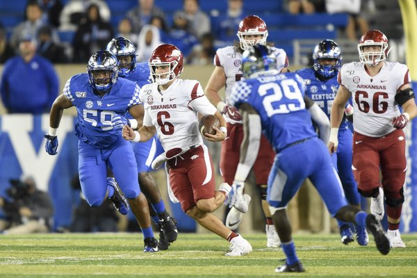 Arkansas quarterback Ben Hicks (6) carries the ball Saturday, October 12, 2019 during the fourth quarter of a football game at Kroger Field in Lexington, Ky. Visit nwadg.com/photos to see more photographs from the game.