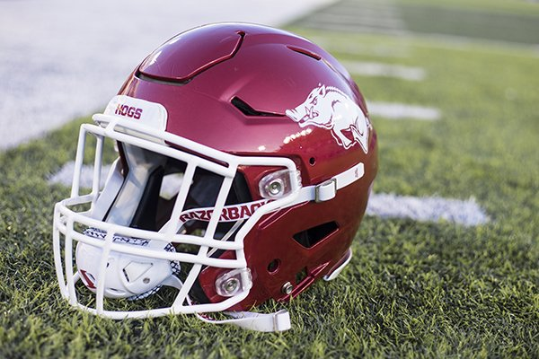 An Arkansas football helmet sits on the ground prior to a game between the Razorbacks and Kentucky on Saturday, Oct. 12, 2019, in Lexington, Ky.