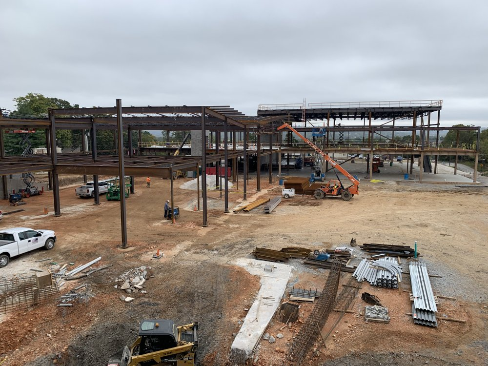 Construction crews work on the expansion of the Fayetteville Public Library on Tuesday, Oct. 16, 2019.