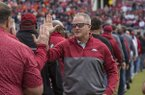 Arkansas athletics director Hunter Yurachek greets players from the Razorbacks' 1989 football team during a game against Auburn on Saturday, Oct. 19, 2019, in Fayetteville.
