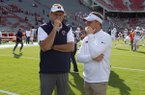 FILE — Auburn coach Gus Malzahn (left) and then-Arkansas coach Chad Morris speak prior to a game Saturday, Oct. 19, 2019, in Fayetteville.