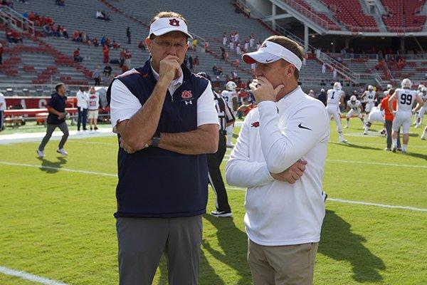 FILE — Auburn coach Gus Malzahn (left) and then-Arkansas coach Chad Morris speak prior to a game Saturday, Oct. 19, 2019, in Fayetteville.