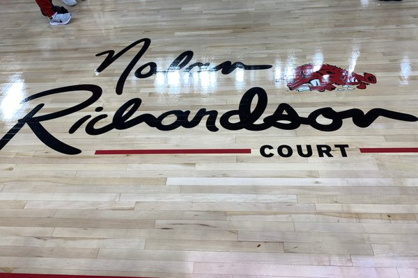 The logo for Nolan Richardson Court at Bud Walton Arena is shown Sunday, Oct. 20, 2019, prior to a game between Arkansas and Arkansas-Little Rock in Fayetteville.