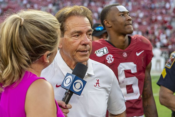 Alabama head coach Nick Saban talks with CBS after a 59-31 win over Ole Miss in an NCAA college football game, Saturday, Sept. 28, 2019, in Tuscaloosa, Ala. (AP Photo/Vasha Hunt)