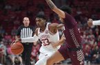 Arkansas guard Jimmy Whitt Jr. drives against Arkansas-Little Rock defender Jaizec Lottie during an exhibition game Sunday, Oct. 19, 2019, in Fayetteville.