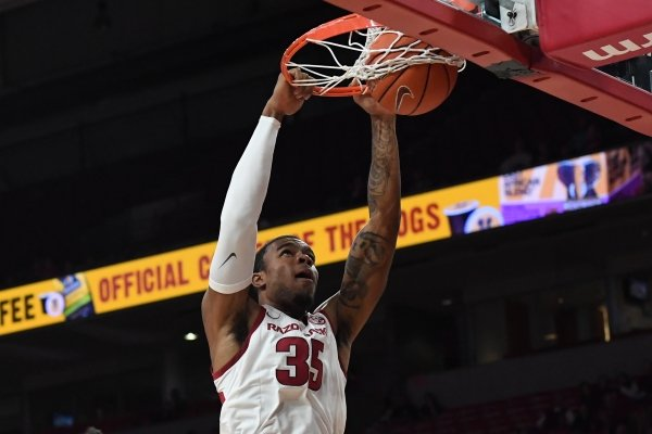 Reggie Chaney dunks in Arkansas' 78-51 win over Southwestern Oklahoma State on Friday, Oct. 25, 2019 at Bud Walton Arena.