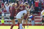 Arkansas' Taylor Malham (middle) celebrates with teammates after scoring a goal in the 85th minute of the Razorbacks' game against Georgia on Sunday, Oct. 27, 2019, in Fayetteville.