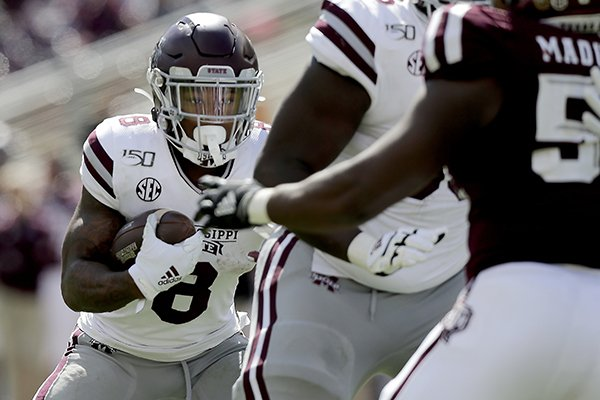 Mississippi State running back Kylin Hill (8) looks to run behind his offensive line against Texas A&M during the second half of an NCAA college football game, Saturday, Oct. 26, 2019, in College Station, Texas. (AP Photo/Sam Craft)