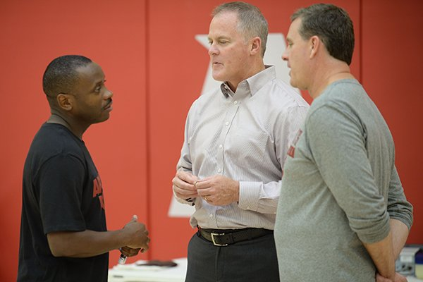 Earl Boykins (from left), Arkansas director of student-athlete development, speaks Thursday, Sept. 26, 2019, with Hunter Yurachek, director of athletics, and assistant coach Clay Mosier during practice in the Eddie Sutton Gymnasium inside the Basketball Performance Center in Fayetteville.