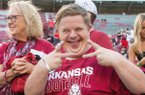 Canaan Sandy, an Arkansas 'super fan' greets players after players after defeating Portland State 20-13 Saturday, Aug. 31, 2019, at Reynolds Razorback Stadium in Fayetteville.