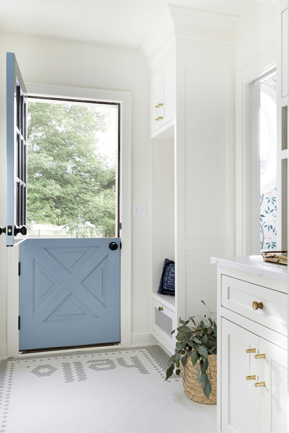 """Designer Bria Hammel used hex tile to spell out """"Hello"""" in an entryway. A custom border extends to the adjacent powder room. MUST CREDIT: Spacecrafting Photography"""