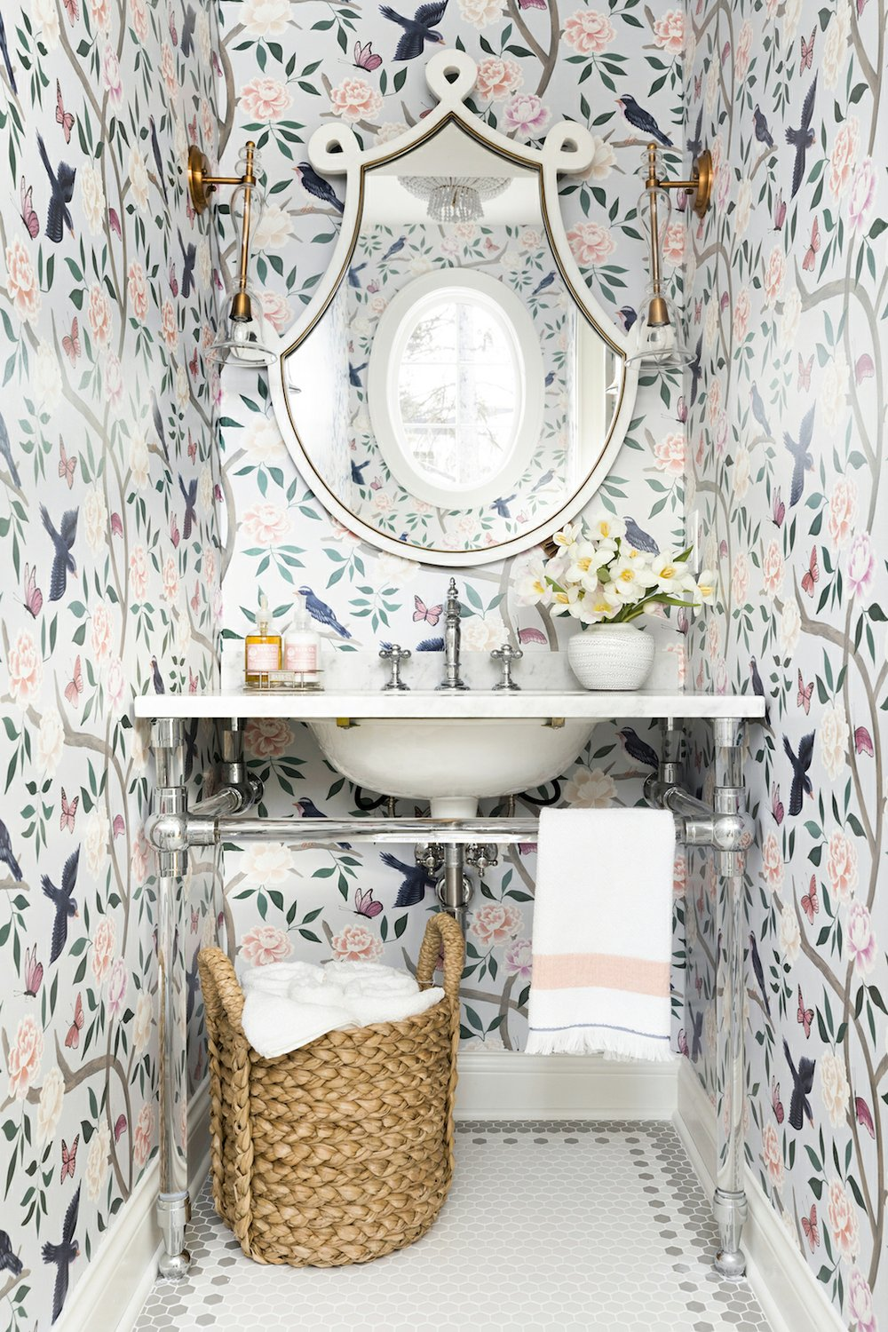 A powder room by Bria Hammel pairs a more subdued mosaic floor with bold wallpaper. MUST CREDIT: Spacecrafting Photography
