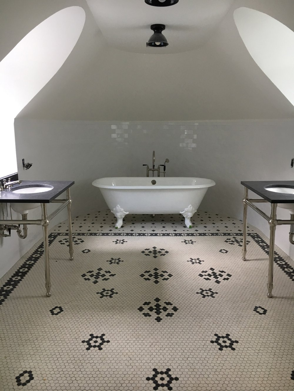 Blue and white mosaic tiles create different zones in this attic bath by Allison Tick. MUST CREDIT: Allison Tick