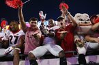 """Georgia defensive back J.R. Reed (20) does the """"gator chop"""" with fans in celebration after after the team's win over Florida in an NCAA college football game Saturday, Nov. 2, 2019, in Jacksonville, Fla."""