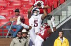 Mississippi State receiver Osirus Mitchell catches a touchdown pass over Arkansas cornerback LaDarrius Bishop during a game Saturday, Nov. 2, 2019, in Fayetteville.
