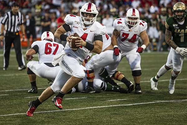Western Kentucky quarterback Ty Storey (4) scrambles against UAB during an NCAA college football game, Saturday, Sept. 28, 2019, in Bowling Green, Ky. (Austin Anthony/Daily News via AP)