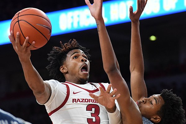 Arkansas guard Desi Sills goes up for a shot against Rice guard Trey Murphy during a game Tuesday, Nov. 5, 2019, in Fayetteville.