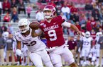 Arkansas Freshman John Stephen Jones (9) shotputs the ball in the 3rd quarter against Mississippi State