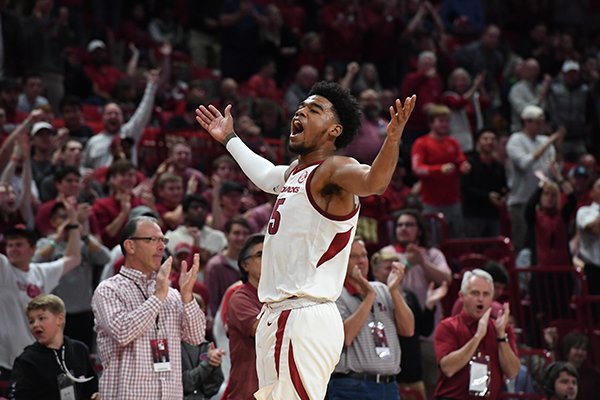 Arkansas guard Mason Jones (15) celebrates during a game against Rice on Tuesday, Nov. 5, 2019, in Fayetteville.