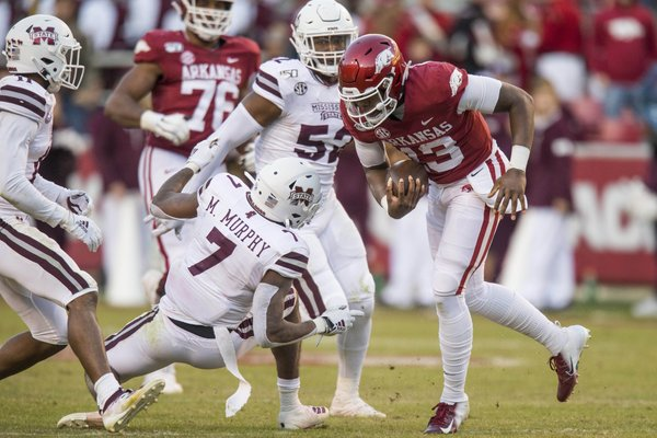 K.J. Jefferson, Arkansas quarterback, breaks the tackle of Marcus Murphy, Mississippi State free safety, in the fourth quarter Saturday, Nov. 2, 2019, at Reynolds Razorback Stadium in Fayetteville.