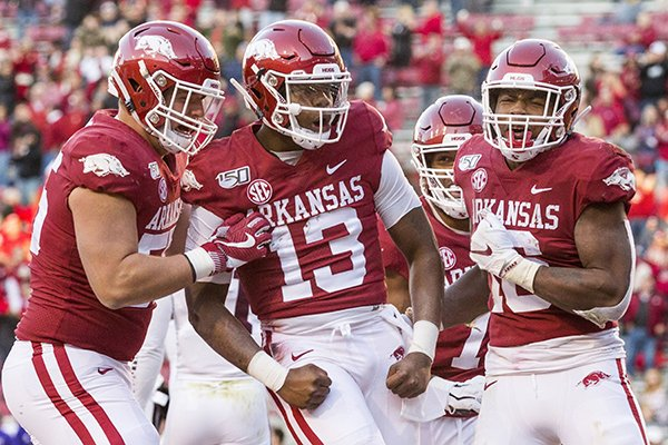 Arkansas quarterback KJ Jefferson (13) celebrates with teammates after scoring a touchdown during the fourth quarter of a game against Mississippi State on Saturday, Nov. 2, 2019, in Fayetteville.