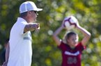 Arkansas soccer coach Colby Hale yells to his team while Abbi Neece prepares for a throw in during a game against Georgia on Sunday, Oct. 27, 2019, in Fayetteville.
