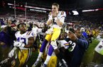 LSU quarterback Joe Burrow (9) is carried off the field by his teammates after defeating Alabama 46-41 in an NCAA college football game, Saturday, Nov. 9, 2019, in Tuscaloosa , Ala. (AP Photo/John Bazemore)