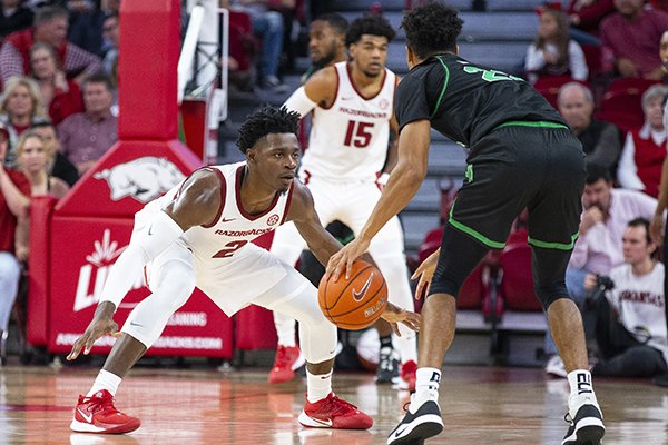 Arkansas' Adrio Bailey (2) and Mason Jones (15) play defense during a game against North Texas on Tuesday, Nov. 12, 2019, in Fayetteville.