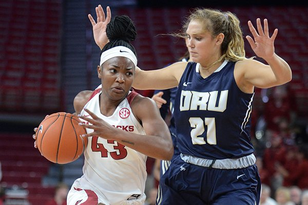 Arkansas guard Makayla Daniels (43) drives to the lane Thursday, Nov. 14, 2019, as she is pressured by Oral Roberts guard Rylie Torrey during the first half of play in Bud Walton Arena.