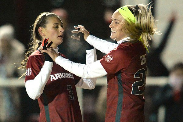 Arkansas' Parker Goins (right) and Tori Cannata celebrate after Goins scored a goal during an NCAA Tournament game against North Texas on Friday, Nov. 15, 2019, in Fayetteville.