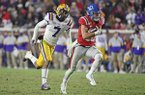 Ole Miss quarterback John Rhys Plumlee (10) carries the ball past LSU safety Grant Delpit (7) during the second half of an NCAA college football game in Oxford, Miss., Saturday, Nov. 16, 2019. LSU won 58-37. (AP Photo/Thomas Graning)