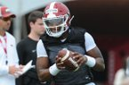 Arkansas quarterback K.J. Jefferson rolls out with the ball Friday, Aug. 2, 2019, during practice at the university practice field in Fayetteville. Visit nwad.com/photos to see more photographs from the practice.
