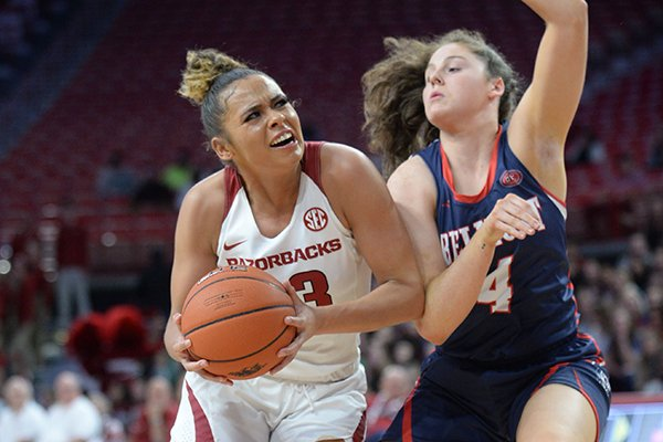 Arkansas guard Chelsea Dungee (left) drives Wednesday, Nov. 20, 2019, past Belmont guard Macie Culbertson during the first half of play in Bud Walton Arena. Visit nwadg.com/photos to see more photographs from the game.