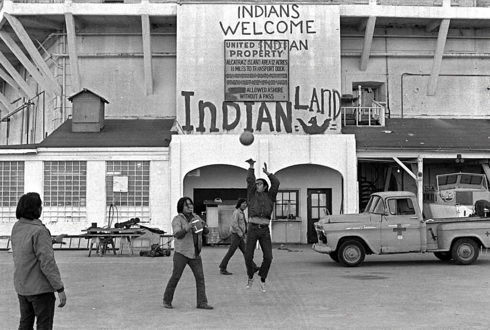 In this Nov. 26, 1969, file photo, Native Americans play ball games at the main dock area on Alcatraz in San Francisco during their occupation of the island. The week of Nov. 18, 2019, marks 50 years since the beginning of a months-long Native American occupation at Alcatraz Island in the San Francisco Bay. The demonstration by dozens of tribal members had lasting effects for tribes, raising awareness of life on and off reservations, galvanizing activists and spurring a shift in federal policy toward self-determination. (AP Photo/File)