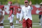 Then Arkansas assistant coach Barry Lunney Jr. directs his players Thursday, Aug. 9, 2018, during practice at the university's practice facility in Fayetteville.