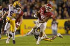 Arkansas running back Rakeem Boyd (5) carries the ball during a game against LSU on Saturday, Nov. 23, 2019, in Baton Rouge, La.