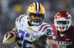 Arkansas defensive back Joe Foucha (7) reaches for Louisiana running back Clyde Edwards-Helaire (22) as he runs the ball in for a touchdown, Saturday, November 23, 2019 during the second quarter of a football game at Tiger Stadium in Baton Rouge, La. Visit nwadg.com/photos to see more photographs from the game.