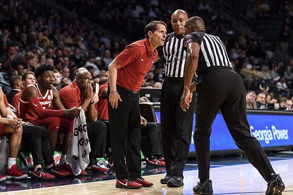 Arkansas head coach Eric Musselman speaks to the referees in the first half of an NCAA college basketball game against Georgia Tech Monday, Nov. 25, 2019, in Atlanta. Arkansas won 62-61. (AP Photo/Danny Karnik)