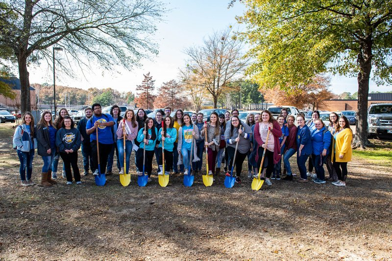 Education majors at Southern Arkansas University hold blue and gold shovels to break ground for the new Education Building Monday, November 25, 2019.