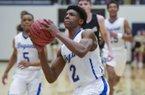 NWA Democrat-Gazette/CHARLIE KAIJO Bryant High School Khalen Robinson (2) shoots during a basketball game, Saturday, March 2, 2019 at Bentonville West High School in Centerton.