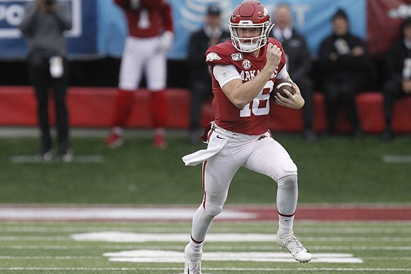 Arkansas quarterback Jack Lindsey (18) runs the ball during the second quarter of the Razorbacks' 24-14 loss to Missouri on Friday, Nov. 29, 2019, at War Memorial Stadium in Little Rock.