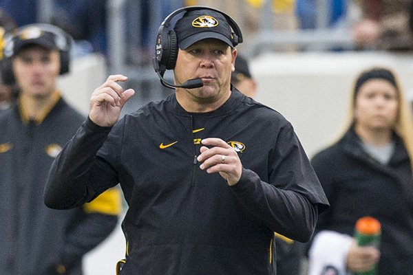 Missouri coach Barry Odom is shown during a game against Arkansas on Friday, Nov. 29, 2019, in Little Rock.