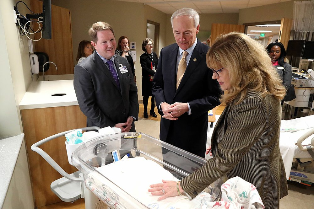 CHI St. Vincent CEO Chad Aduddell, left, and Gov. Asa Hutchinson tour the new CHI St. Vincent Hot Springs Anthony Childbirth Center with Marsha Oliver, nurse manager for women's services, on Monday. - Photo by Richard Rasmussen of The Sentinel-Record