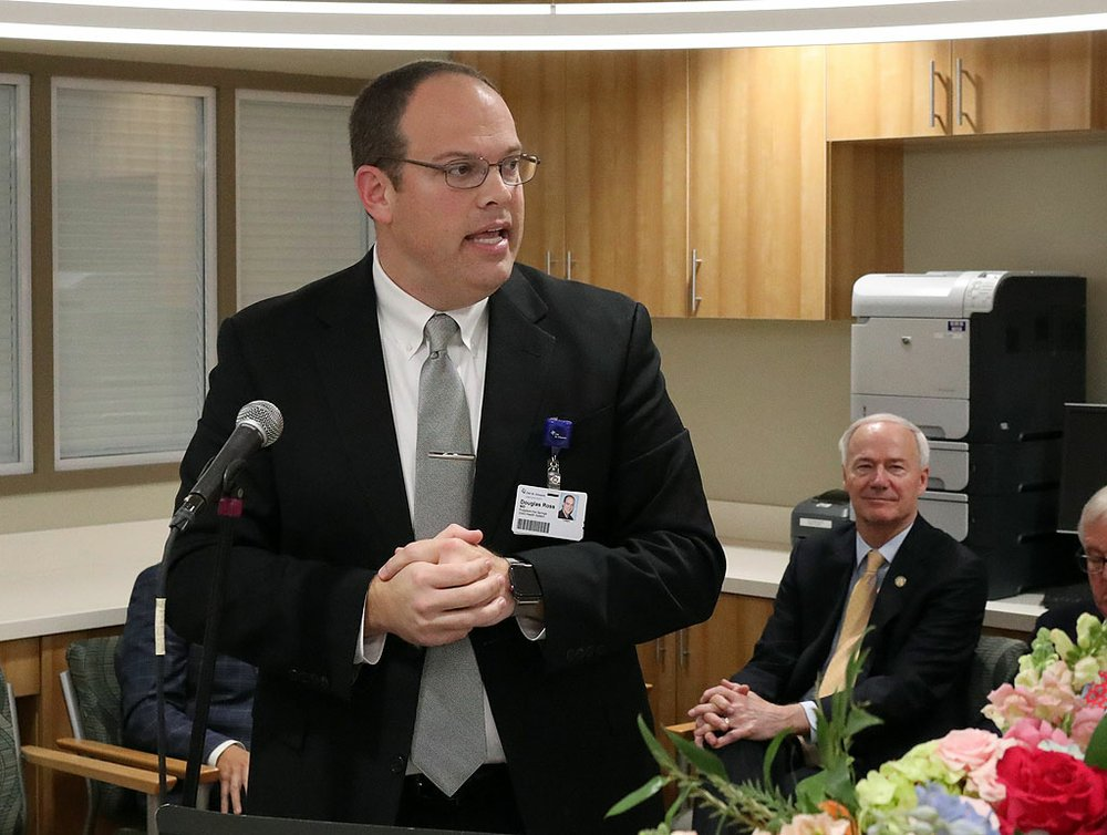 CHI St. Vincent Hot Springs President Dr. Doug Ross speaks as Gov. Asa Hutchinson listens during the grand opening for the CHI St. Vincent Hot Springs Anthony Childbirth Center on Monday. - Photo by Richard Rasmussen of The Sentinel-Record