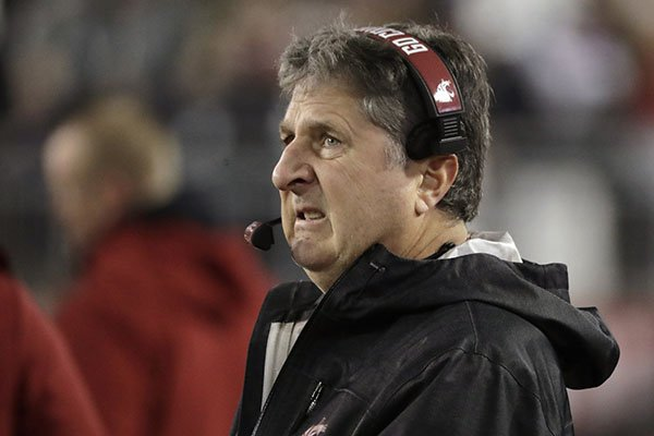 Washington State coach Mike Leach looks toward the scoreboard during the first half of the team's NCAA college football game against Oregon State, Saturday, Nov. 23, 2019, in Pullman, Wash. (AP Photo/Ted S. Warren)