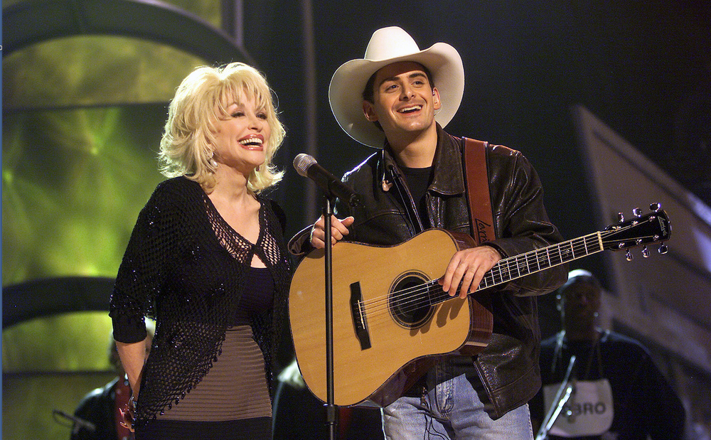 Dolly Parton and Brad Paisley rehearse for their duet for the 2001 Grammy Awards show. (AP)