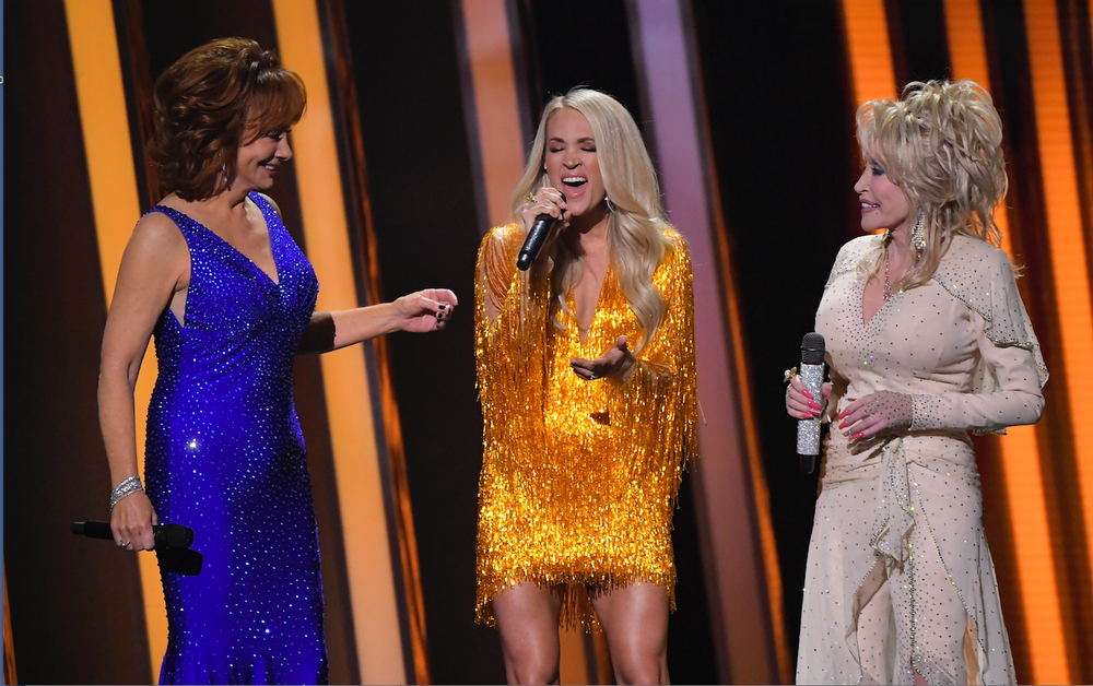 Three country music powerhouses co-hosted this year's Country Music Association Awards — Reba McEntire (from left), Carrie Underwood and Dolly Parton. Parton was named entertainer of the year in 1978; McEntire won in 1986. Underwood was nominated this year and in 2016, but lost both times. (AP)