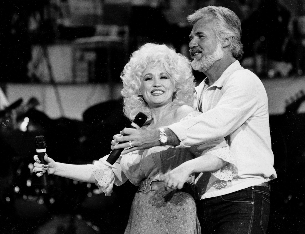 """Dolly Parton and Kenny Rogers were a very successful duo with the No. 1 pop and country smashes """"Islands in the Stream"""" (1983) and """"Real Love"""" (1985). They also co-starred in a Christmas TV special in 1984. (AP)"""